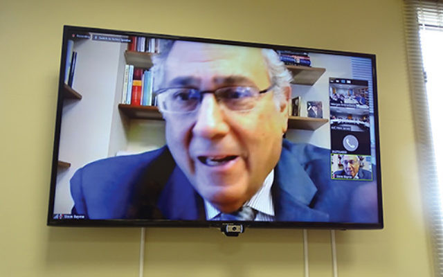 Israeli expert Steven Bayme addresses New Jersey American Jewish Committee members via closed circuit television. Photos by Robert Wiener