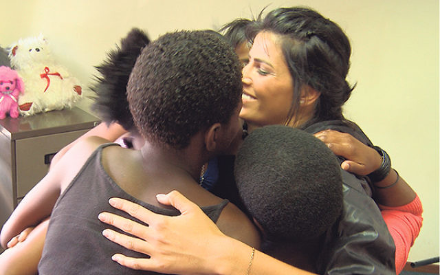 Linor Abargil hugs a group of teenage rape survivors in Soweto, South Africa.