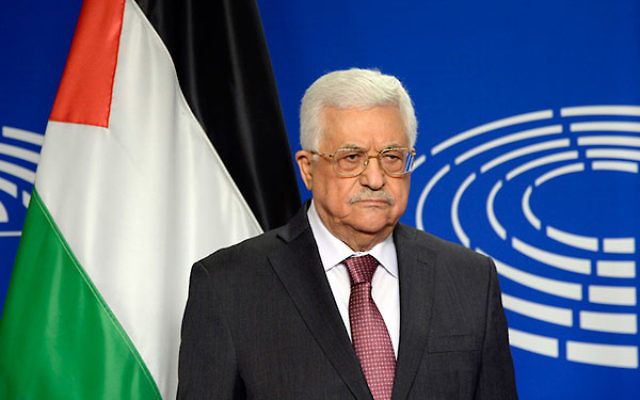 Palestinian Authority President Mahmoud Abbas posing for photographs at the European Parliament in Brussels, June 23, 2016. (Thierry Charlier/AFP/Getty Images)