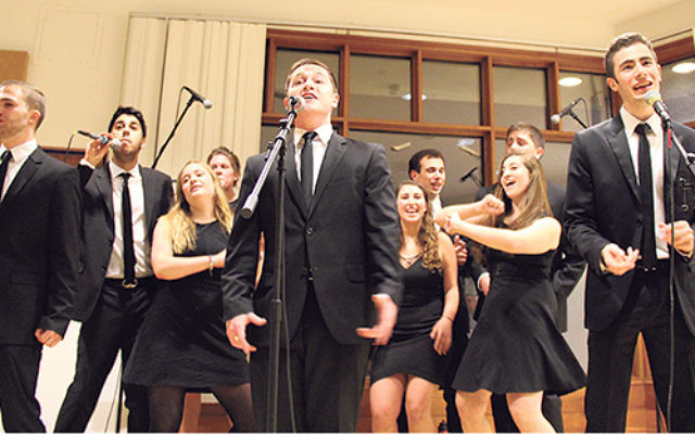 Louis Ades of Oakhurst, far right, sings with Shir Appeal at Tufts University