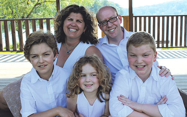Rabbi Benjamin Adler with his children, from left, Ronen, Miya, and Jonah, and wife Lisa at White Meadow Lake last June.