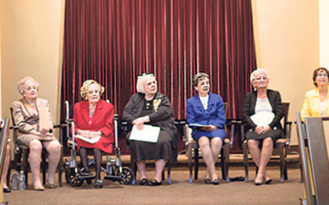 Rabbi Nasanayl Braun, right, congratulated nine adult women congregants who comprised the first-ever bat mitzva class at 119-year-old Congregation Brothers of Israel in Elberon. They are, from left, Madeline Forman, West Long Branch; Marlene Cohn, Oakhurs