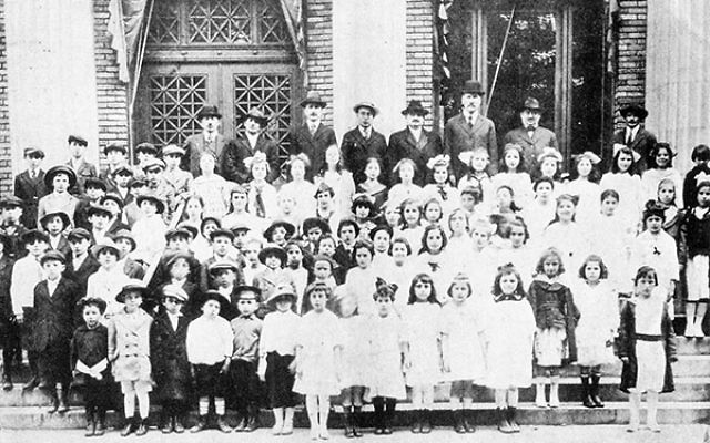 Children and synagogue leaders celebrate Congregation Ahavas Achim's new Sunday School in 1903.