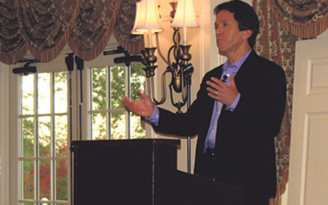 Mitch Albom tells the gathering at Green Brook Country Club about the chance events that turned the former sports writer into one of the world's best-selling authors.
