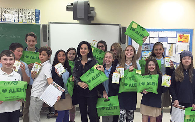 """The sixth-graders of Solomon Schechter Day School and """"Morah Mati"""" send their message."""