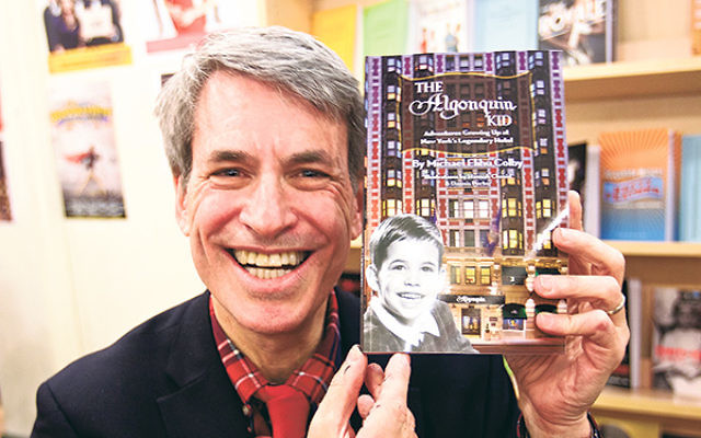 Michael Elihu Colby with his book The Algonquin Kid, which is filled with anecdotes from his star-studded childhood at the famed hotel, which was owned by his grandparents.