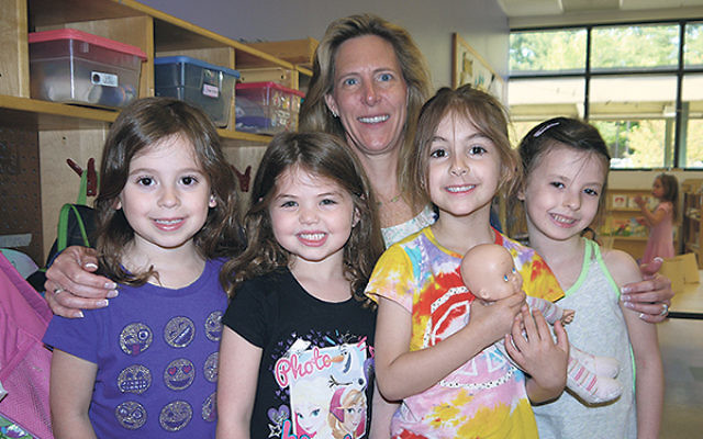 Amy Nelson with youngsters at JCC MetroWest's preschool, where she became director on May 1.