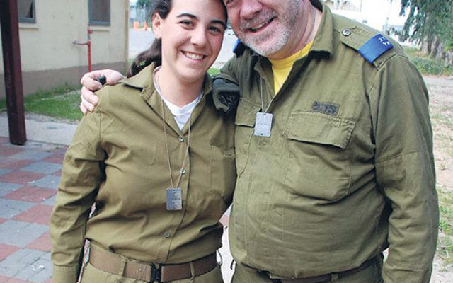 Anat Litwok with her father, Steve, on an army base in Israel in March 2012, when he was serving in Sar-El: National Project for Volunteers for Israel.