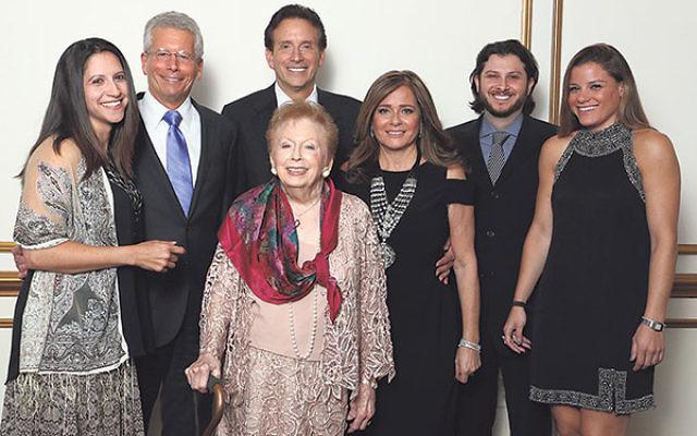 Legacy Award winner Sylvia Scheininger, center, with family members, from left, granddaughter Debra Scheininger, sons Michael and Jeffrey Scheininger, daughter-in-law Manette Scheininger, and grandchildren Danny Scheininger and Ava Scheininger.