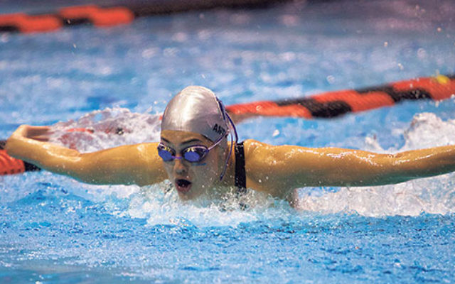 Antiles swimming butterfly at a Columbia University meet.