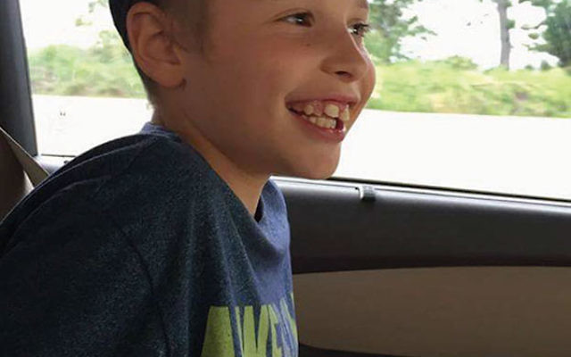 Ari Goodman, an eight-year-old East Windsor boy with autism, whose parents seek financial help to continue his stem cell treatments.
