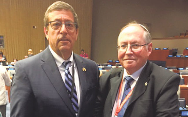 Mark Levenson, president of NJ State Association of Jewish Federations, left, with Elyakim Rubinstein, vice president of Israel's Supreme Court, at the United Nations conference on the anti-Israel Boycott, Divestment, and Sanctions movement. &