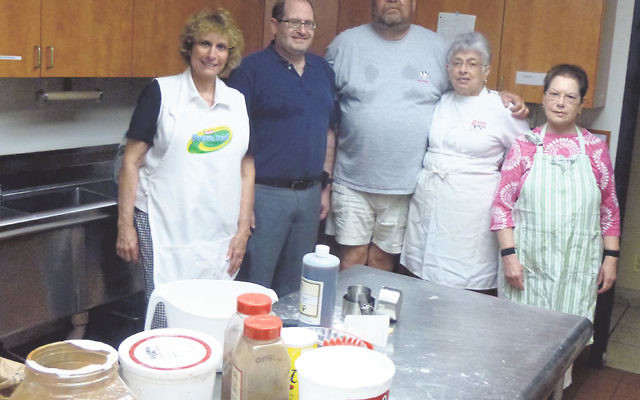 The Temple Beth El of Somerset baking team includes, from left, Dianne Foss, Rabbi Eli Garfinkel, Ira and Sheri Messer, and Janet Goldstein.