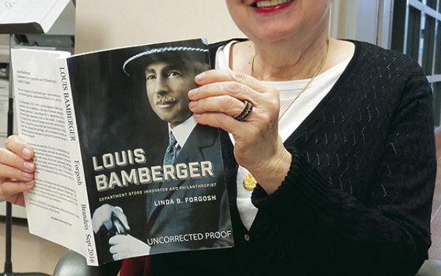 Linda Forgosh holds a copy of her new book, Louis Bamberger: Department Store Innovator and Philanthropist.