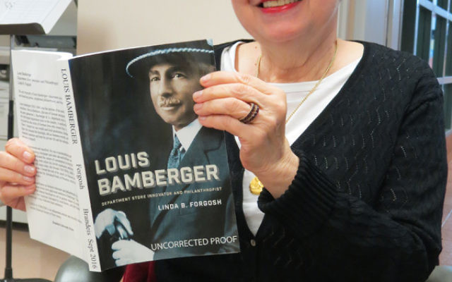 Linda Forgosh, director of the Jewish Historical Society of NJ, holds her book, Louis Bamberger: Department Store Innovator and Philanthropist.