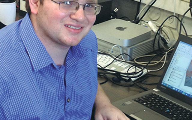 Jonathan Falk at work on his computer studying temperature patterns during his summer internship at Bar-Ilan University in Israel.
