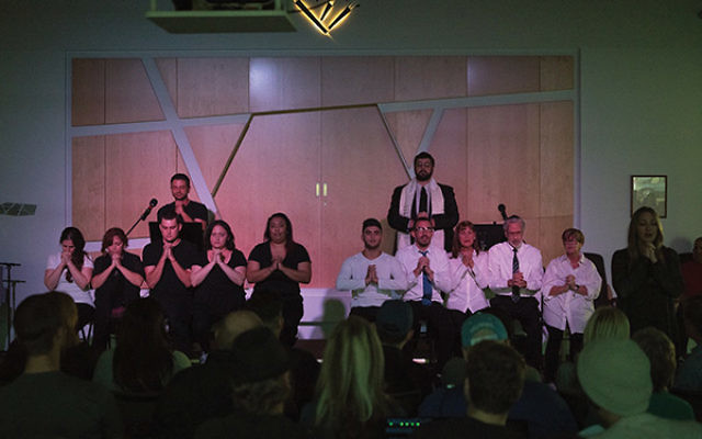 """Benjamin Litchman, on right, second from left, who recovered from a heroin addiction with the help of Beit T'Shuvah, performs in """"Freedom Song."""" Photo courtesy Beit T'Shuvah"""