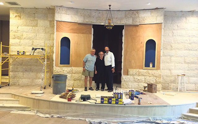 Admiring progress on the new sanctuary with designer Michael Berkowicz, center, are past Beth Ahm presidents Ken Philmus of Matawan, left, and Stu Abraham of Manalapan, program manager and chair, respectively, of the renovation project.
