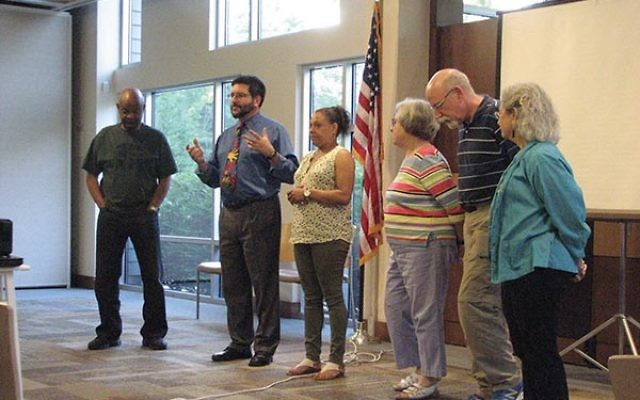 Adult participants in Better Together — from left, Ronald Lilly, Rabbi Joel Abraham, Zaniah Green, Sandy Abraham, David Lieberfarb, and Margaret Cohen — discuss what they gained from the program.