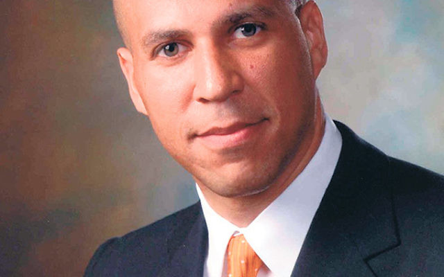"Sen. Cory Booker said he is ""spending countless hours reviewing the deal."""