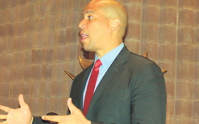 """Sen. Cory Booker told an audience at Temple B'nai Abraham in Livingston, """"We are at this weird moment in history where Congress is not practicing economic sense."""""""