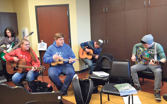 Participants in the Songleader Boot Camp get into the music.