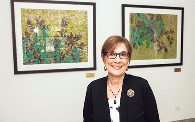Jean Burdick on June 9 donated her prints, Dual Shadows, left, and Trailing, to hang in the lounge named in memory of her aunt and uncle, Lucille and Sidney Burdick, at Yeshiva University.