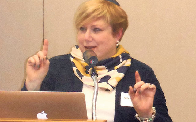 """Rabbi Shira Stern spells out ways to """"get in the boat"""" with elderly clients, at the CARES professional development program in Whippany."""