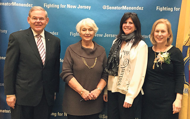 Joining Sen. Robert Menendez in pressing for passage of the International Violence Against Women Act are, from left, Merle Kalishman, former chair of the Community Relations Committee of Greater MetroWest NJ; CRC director Melanie Roth Gorelick; and Sen. K