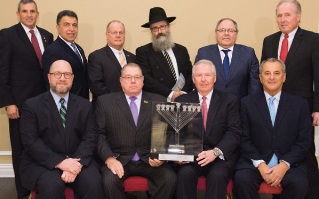 Honorees and dignitaries attending the dinner, seated from left, Attorney General Christopher Porrino; Port Authority Police superintendent Michael Fedorko; Dennis Kelly, and Chabad board chair Danny Kahane. Standing from left, Lt. General Michael Linning