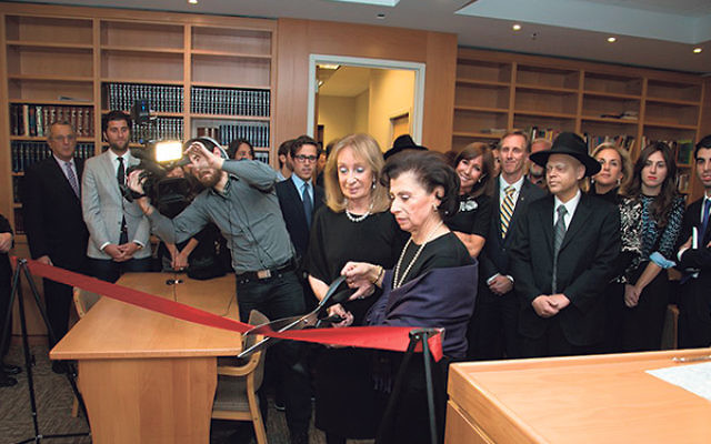Grace Ashkenazi, widow of Ely Ashkenazi, cuts the ribbon on the Franco-Ashkenazi Family Sephardic Synagogue at Rutgers Chabad as Ruby Franco, the widow of Harry Franco, looks on.