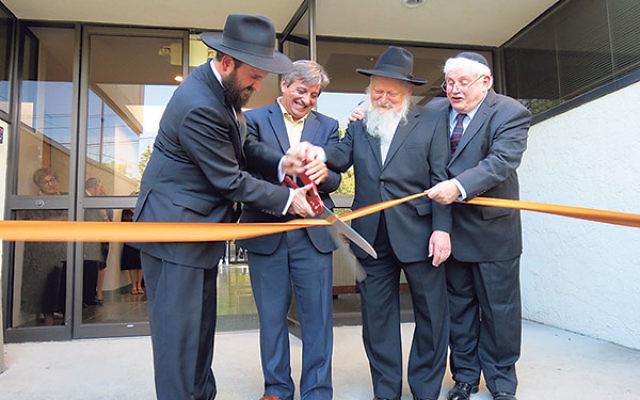 Cutting the ribbon to open the new Chabad of West Orange are, from left, Rabbi Mendy Kasowitz, West Orange Mayor Robert Parisi, RCA dean Rabbi Moshe Herson, and philanthropist Jed Katz.