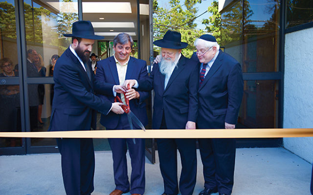Taking part in the ribbon-cutting ceremony of the new Chabad of West Orange in June 2016 are, from left, Rabbi Mendy Kasowitz, Mayor Robert Parisi, Rabbi Moshe Herson, and Jed Katz. Photo by Harry Vine