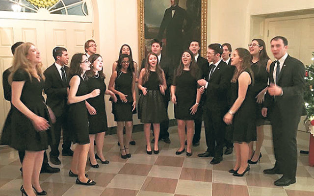 In performance at the White House: the Chai Notes with Kineret Brokman, front row, fifth from left, and Ilan Kaplan, back row, fourth from right.