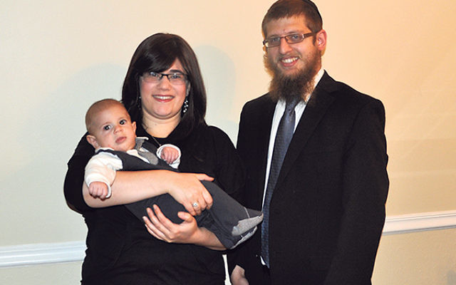 Rabbi Yaakov and Chana Chaiton — with son Levi — at their home in Hamilton.