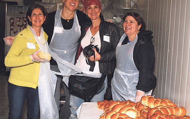 At the Community Challah Bake are, from left, GMW Women's Philanthropy president Joan Levinson, Center for Volunteerism vice president Maxine Schwartz, event cochair Joanie Schwarz, and volunteer June Schechner.