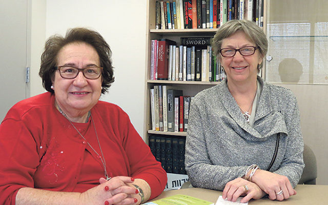 Cecille Asekoff, left, director of the Joint Chaplaincy Committee of Greater MetroWest and executive vice president of the National Association of Jewish Chaplains, and Beth Batastini, a faith community nurse at Christ Episcopal Church in Newton, discuss