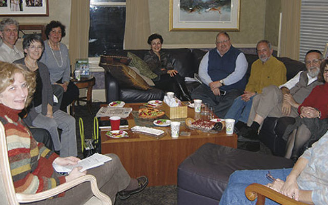 """The 26-year-old group known simply as """"the havura"""" meets at the Barkin home in Cranford: from front left, Laurie Gruber, David Levenberg and Linda Ershow Levenberg, Michael Margolin, Julie Barkin, Nancy Lubarsky, Allen Barkin, Donald"""