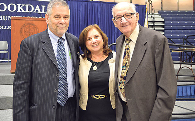 At this year's annual Chhange colloquium, featured speaker Michael Berenbaum, left, told students present that theirs could be the last generation to hear the story of the Holocaust directly from survivors. With him are Chhange executive director Da