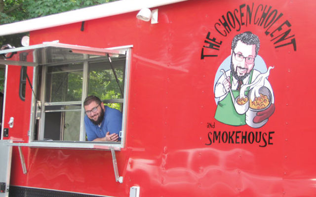 Adam Gindea with his new Chosen Cholent Food Truck in the lot at Ahawas Achim B'nai Jacob & David in West Orange, where he got his start.