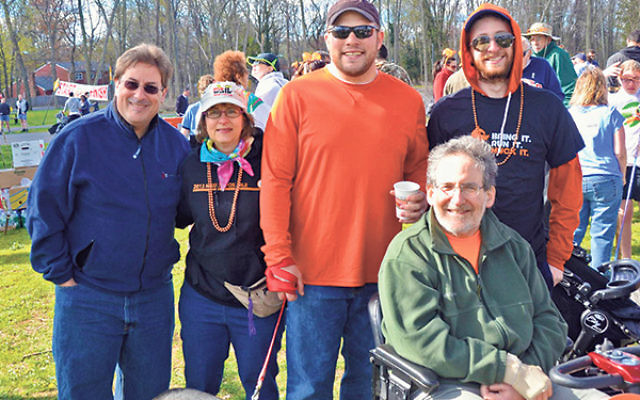 At last year's MS Walk, 2015 Metro NJ Ambassadors Aaron, seated, and Laura Cohen with teammates, from left, Harris Nydick, son-in-law Rabbi Scott Roland, and son Jonathan.
