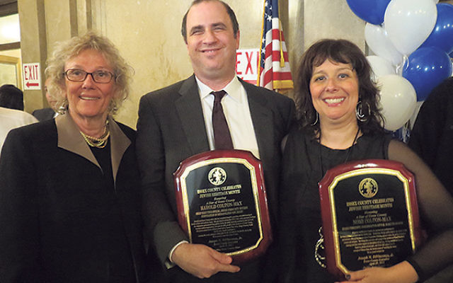 Harold and Nomi Colton-Max display their Star of Essex Awards with Freeholder Pat Sebold, left, at the county's Jewish Heritage Celebration.