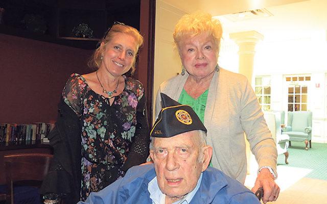 Harry Zaslow shares memories of World War II anti-Semitism with his wife, Naomi, and daughter, Lisa Zaslow Segelman.
