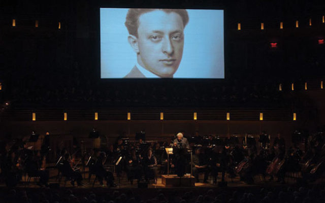 Murry Sidlin talks to his audience at the Music Center at Strathmore in Maryland about Rafael Schachter, who organized the choir of prisoners at Theresienstadt who sang Verdi's Requiem.