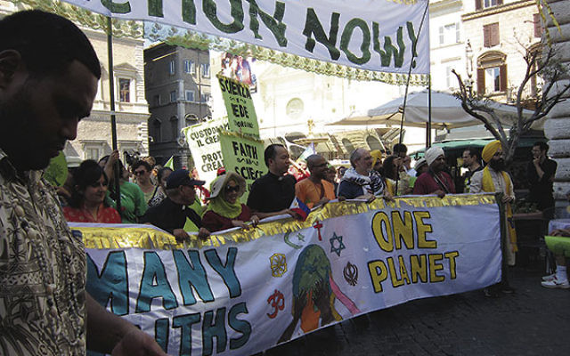 Rabbi Lawrence Troster, third from right, was among the religious leaders at the head of the June 28 march from downtown Rome to the Vatican; they included, from left, a Hindu woman, a Roman Catholic priest, a Muslim woman, a Catholic priest, a Buddhist p