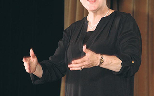 Marsha Edelman conducting a community sing at the 2014 North American Jewish Choral Festival in July.