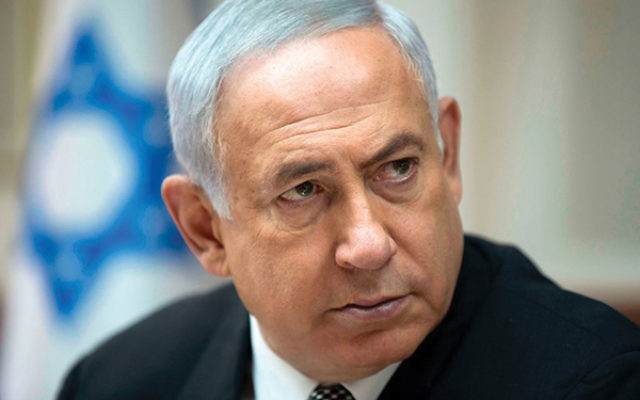 Prime Minister Benjamin Netanyahu at his weekly cabinet meeting on Sept. 3. ABIR SULTAN/AFP/Getty Images