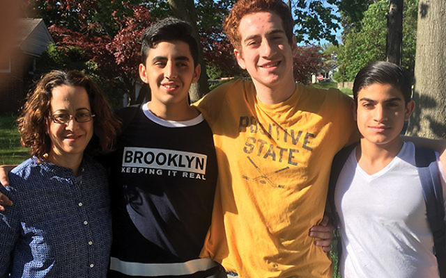 The author, at left, and her family shared New Jersey Jewish life with guests from the Greater MetroWest NJ partnership community of Merchavim. Her son, Gidi Fox, center, is flanked by Oriyan and Ran.