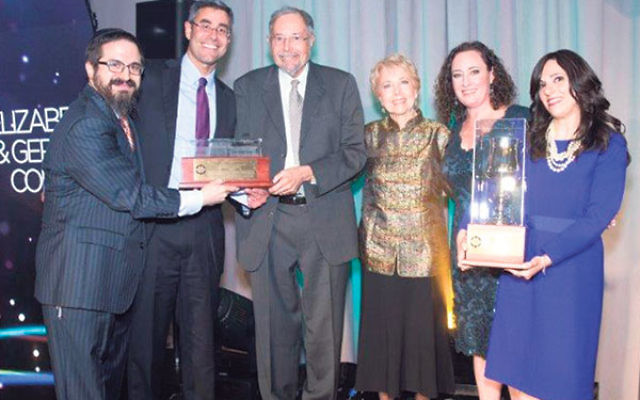 Rabbi Zalman Grossbaum, left, and his wife, Toba, right, with Friendship Circle annual banquet honorees, from left, Gerald Cohen, Dr. Herbert Cohen, Marion Cohen, and Elizabeth Cohen.