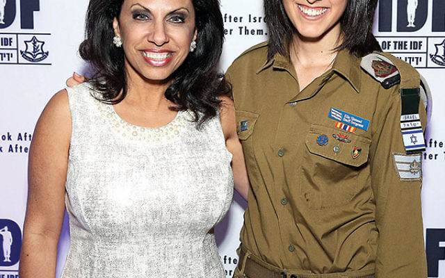 Brigitte Gabriel, a Lebanese Maronite Christian who says the Israel Defense Forces is the most moral military in the world, is joined by an IDF officer at a recent Friends of the IDF dinner in Florida.